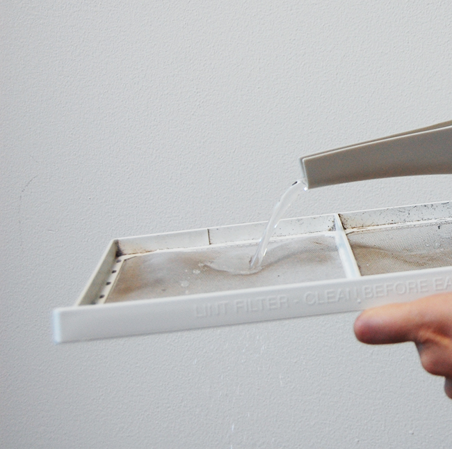 Clean your dryer lint trap with soap and water