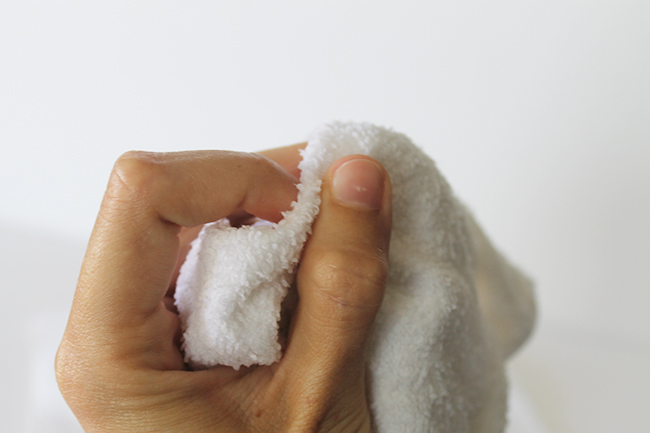 Use a warm, damp towel to clean hands and cuticles for a no polish manicure